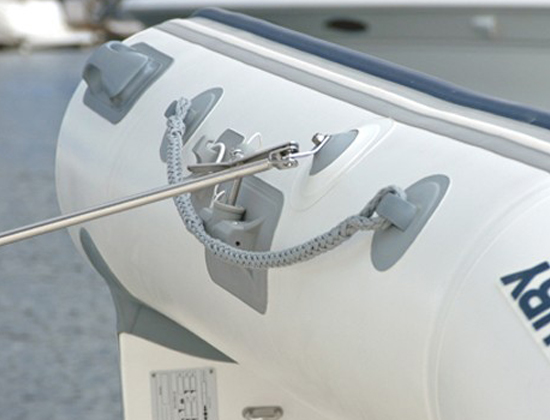 Stand-off pads for inflatable boat